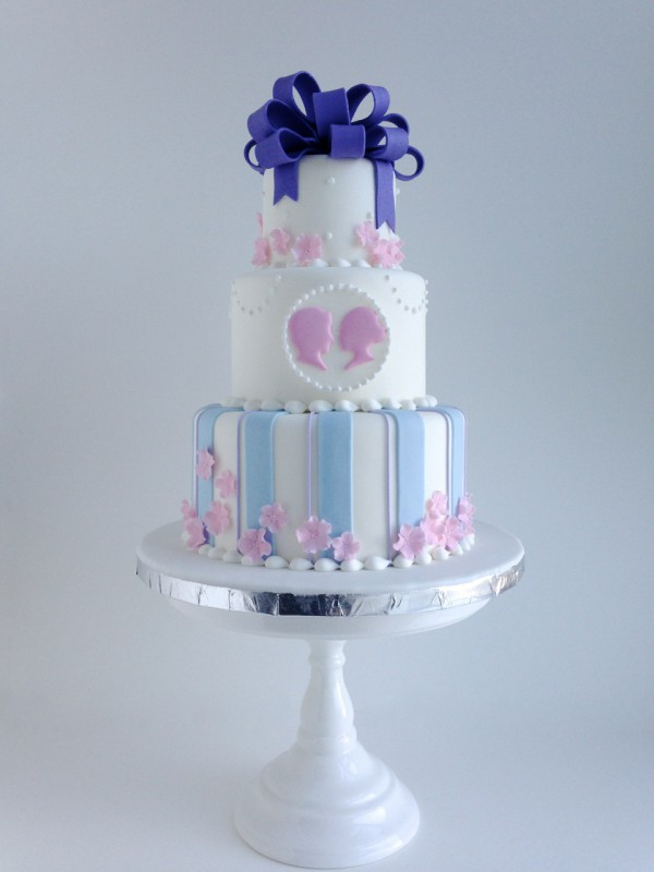 Silhouette bride and groom ribbon bow cake